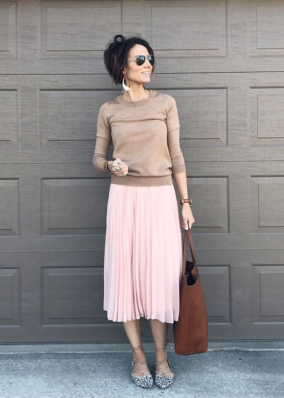 a blush pleated midi skirt, a tan long sleeve and a brown leather tote