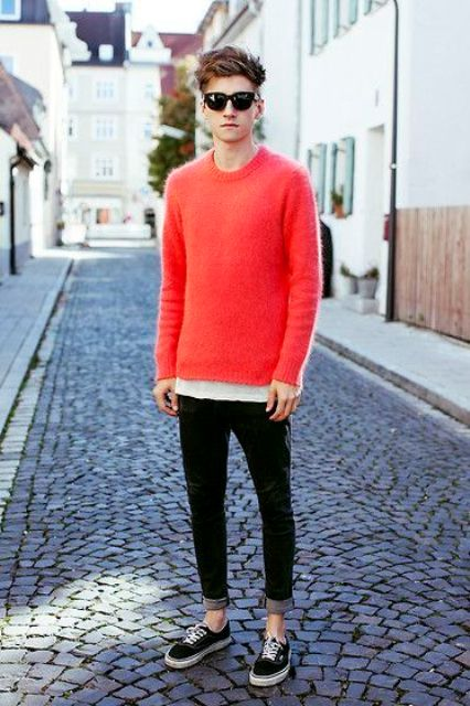 a red sweater, a white tee, black jeans and Vans