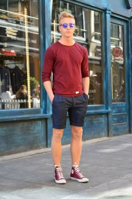 navy shorts, an oxblood long-sleeve and oxblood Converse