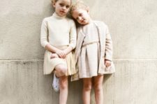 11 neutral tops and over the knee skirts and Converse sneakers