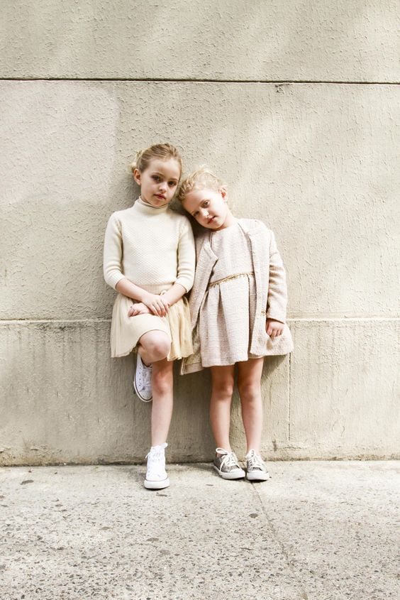 neutral tops and over the knee skirts and Converse sneakers