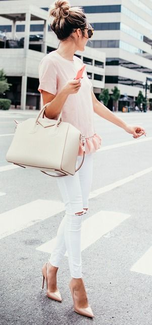 ripped jeans, a blush top and heels