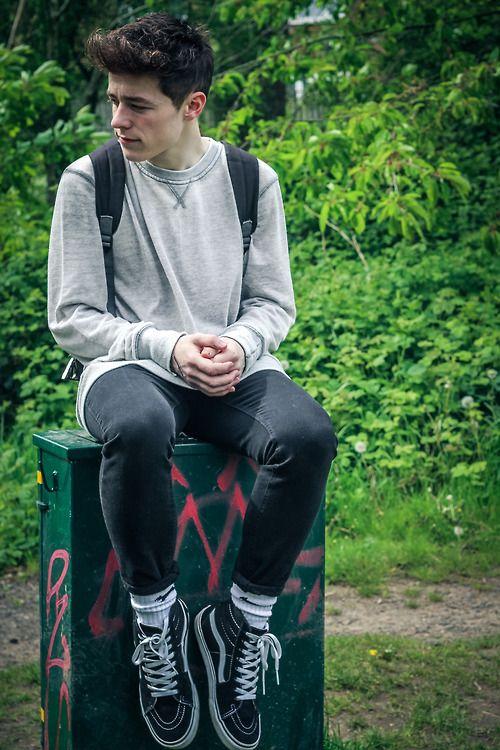 black denim, black Vans, a grey t-shirt and a backpack