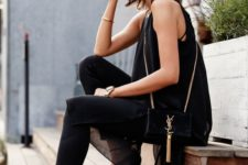 12 black jeans, a chic flowy top and high heels for a date look