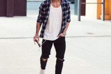 12 black ripped denim, a white tee, a plaid shirt and white sneakers