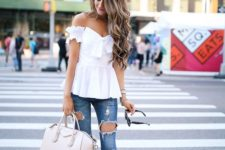 12 distressed skinny jeans, a white off the shoulder top with a bow and lace up heels