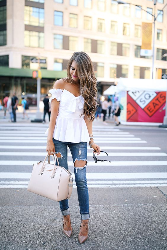 distressed skinny jeans, a white off the shoulder top with a bow and lace up heels