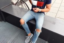 12 grey trainers, a printed navy t-shirt, ripped blue denim