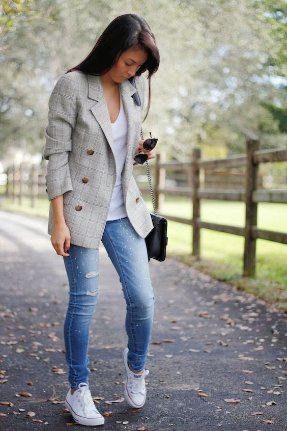 ripped jeans, a white top, a grey checked blazer and white Converse