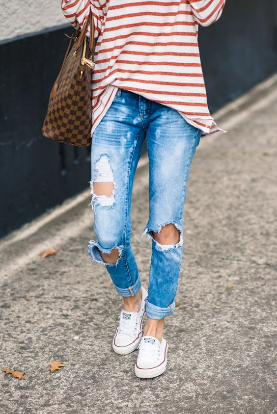 white Converse, a red stripe shirt, ripped denim and a tote