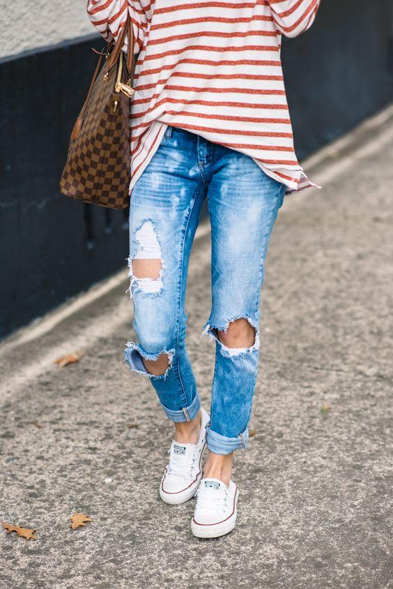white Converse, a red stripe shirt, ripped denim and a tote