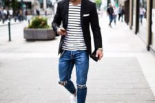13 blue ripped jeans, a striped tee, a black jacket and white sneakers