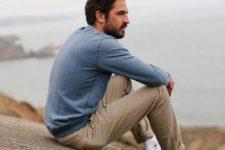 14 a blue long-sleeve, beige pants, white Converse