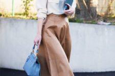 14 a midi leather skirt, an ivory shirt, black heels