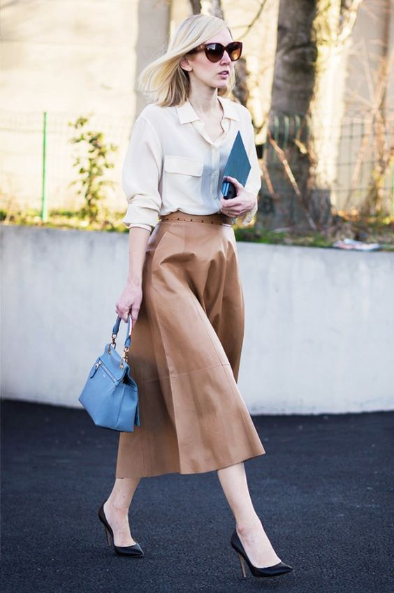 a midi leather skirt, an ivory shirt, black heels