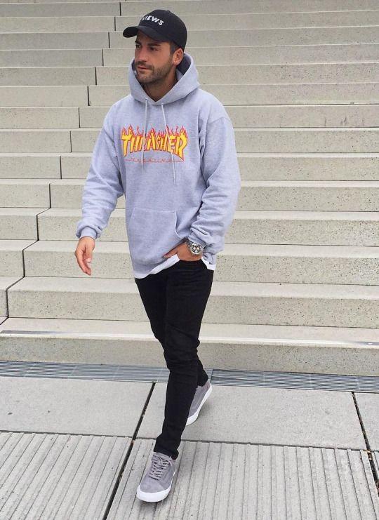 black jeans, a grey sweatshirt and grey Vans