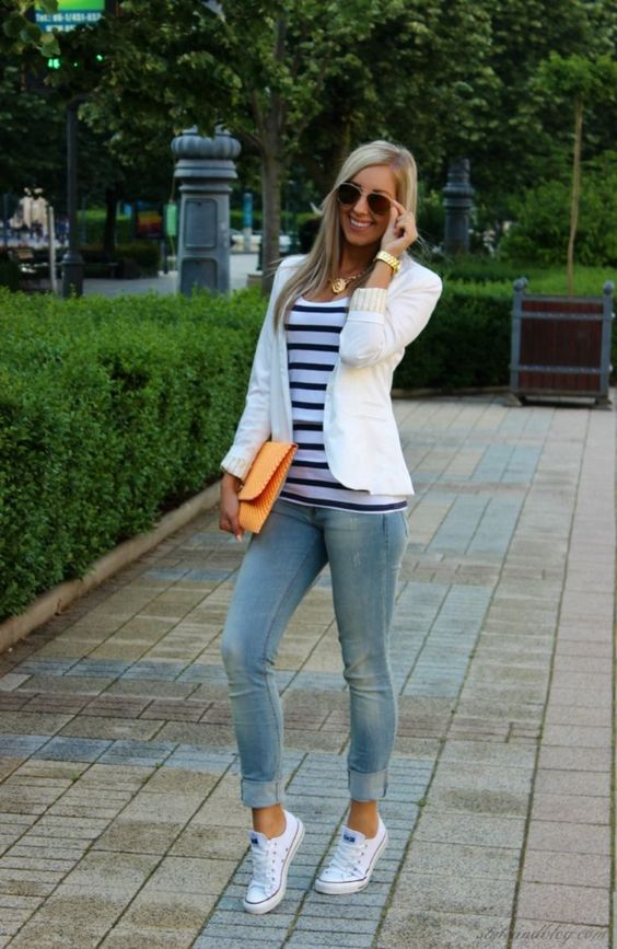 Picture Of blue jeans, a striped tee, a