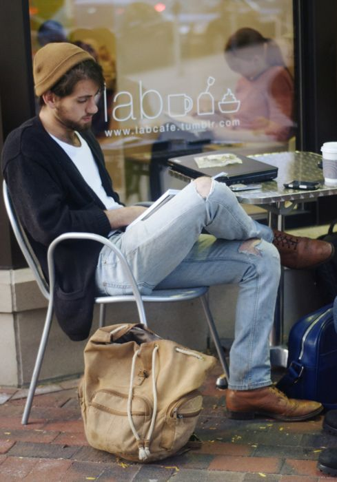 blue ripped jeans, a white tee, a black cardigan ocher shoes and a beanie
