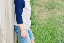 14 denim shorts, a sweatshirt and white Converse