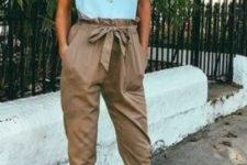 14 neutral high waist pants, a mint sleeveless top and neutral heels