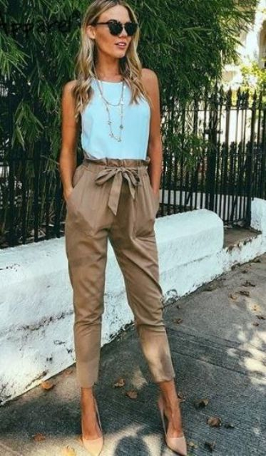 neutral high waist pants, a mint sleeveless top and neutral heels