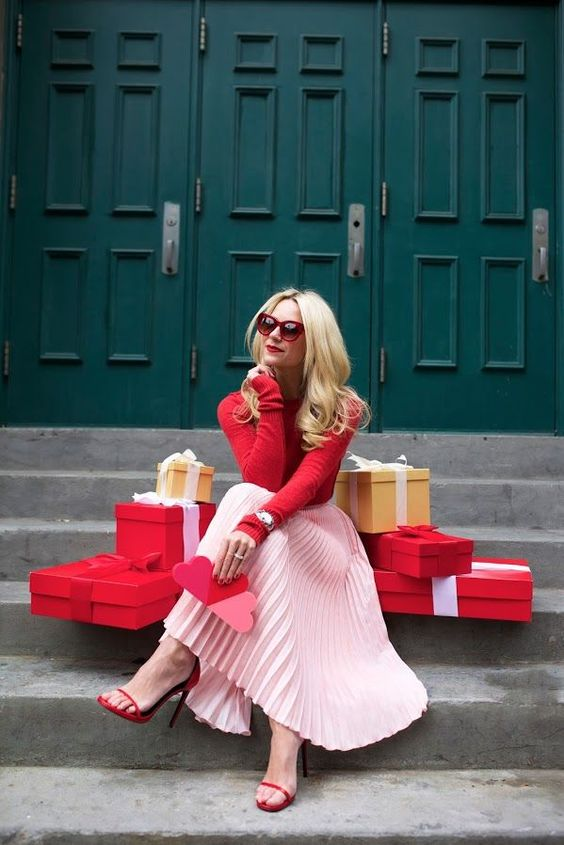 a blush skirt, a red sweater, red heels for a cool color block look