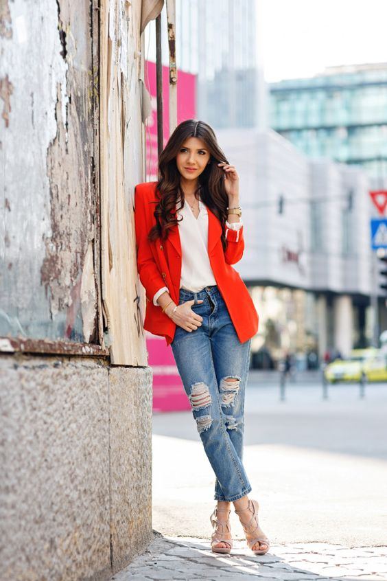 a red blazer, a white top, ripped denim and blush lace up heels