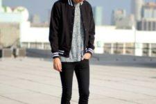 15 black jeans, a printed shirt, a black bomber jacket and black Converse