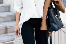 15 black jeans, a white shirt, leopard print heels and a tassel necklace