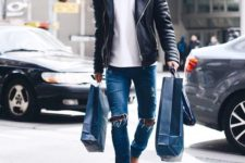 15 blue ripped jeans, a white tee, a black leather jacket and ocher boots
