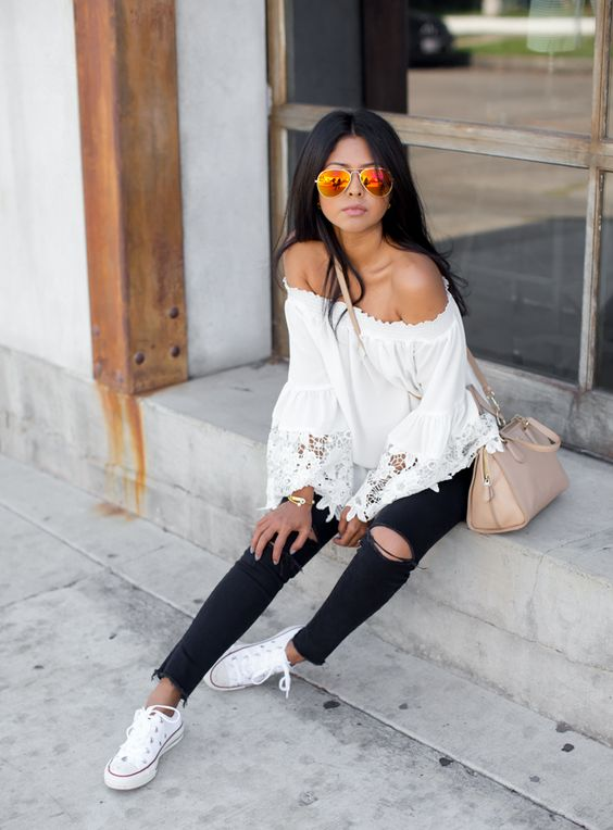 ripped black denim, an ivory boho off the shoulder top and white Converse