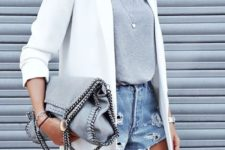 15 ripped blue denim shorts, a grey tee, a white jacket and layered necklaces