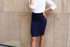 16 a navy over the knee skirt, a white top with half sleeeves and nude heels
