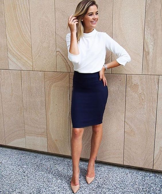 a navy over the knee skirt, a white top with half sleeeves and nude heels