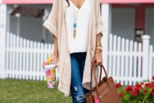 16 a white top, a neutral crochet cardigan, ripped jeans and brown sandals