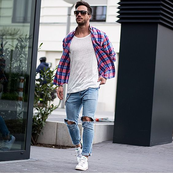blue ripped jeans, white sneakers, a white tee and a plaid shirt