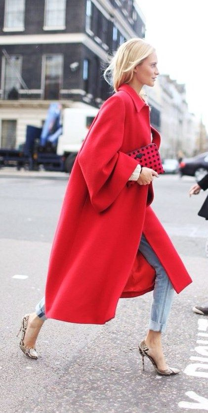jeans, snake print shoes and a long red coat