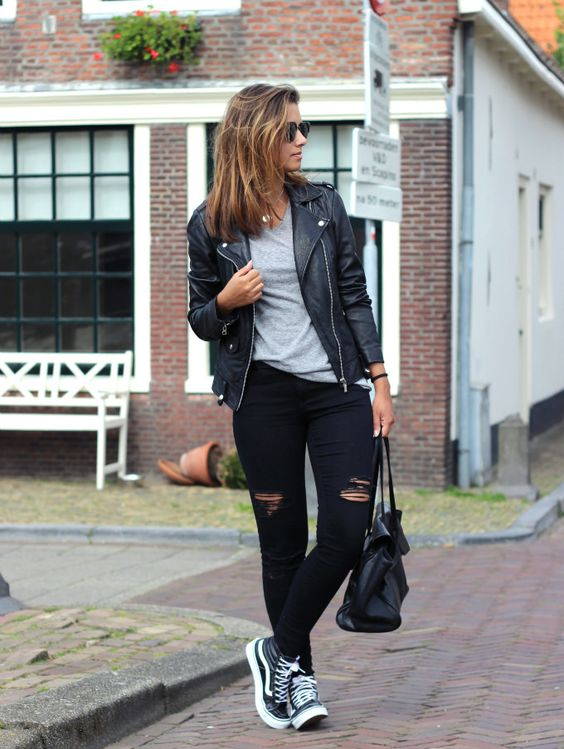 ripped black jeans, a grey t-shirt, black Vans and a black leather jacket