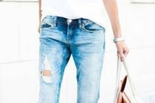 16 ripped blue jeans, a white tee and blush heels