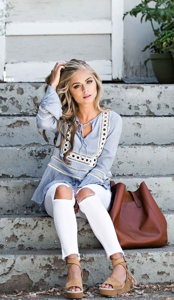 ripped jeans, a light blue boho chic shirt and brown wedges