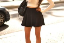 17 a black skater skirt, an ivory sweatshirt and white Converse