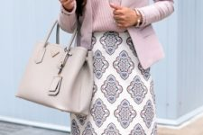 17 a pink V-neck top, a pink blazer and a patterned skirt