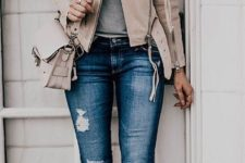 17 grey-nude leather jacket with distressed jeans, grey studded heels and a grey shirt