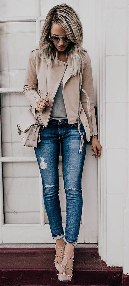 grey nude leather jacket with distressed jeans, grey studded heels and a grey shirt