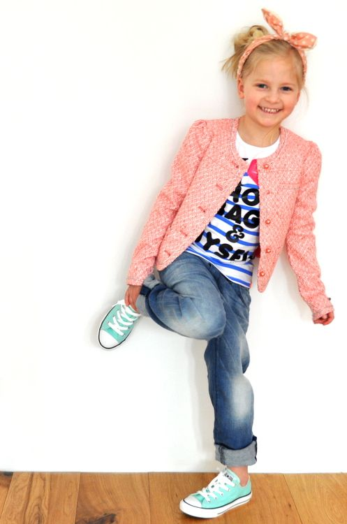 mint Converse, blue jeans, a printed tee and a pink jacket