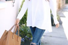 17 ripped blue skinnies, a white off the shoulder top and neutral heels