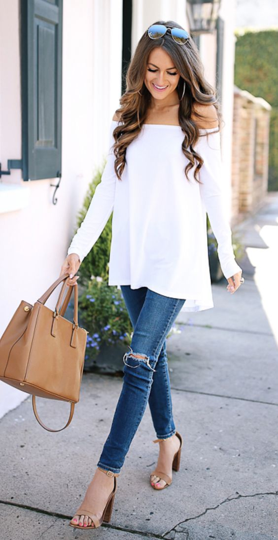 ripped blue skinnies, a white off the shoulder top and neutral heels