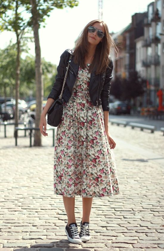 a flower print midi dress, a leather jacket and black Converse