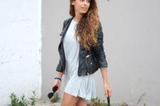 18 a light blue dress, a leather jacket, black and grey Vans
