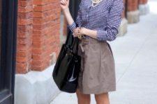 18 a tan skirt, a blue gingham shirt, nude and black flats
